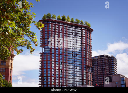 The Woodward's Building with trees on top of the roof, a landmark in the Downtown Eastside of Vancouver, British Columbia, Canada. - Stock Photo