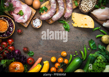 Balanced food background. Organic food for healthy nutrition. Meat beans and vegetables. Top view with copy space on dark stone table. - Stock Photo