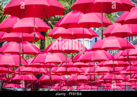 Port Louis, Mauritius - February 12, 2018 - umbrellas create shade on the street in Caudan Waterfront, main shopping district of the capital city - Stock Photo