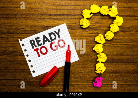 Handwriting text Ready To Go. Concept meaning asking someone if he is prepared or packed his things Paper marker crumpled papers forming question mark - Stock Photo