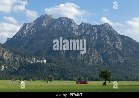 Alps with Neuschwanstein Castle, Hohenschwangau, Allgaeu, Bavaria, Germany - Stock Photo