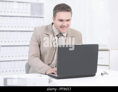 employee of the company working on laptop in the office. - Stock Photo