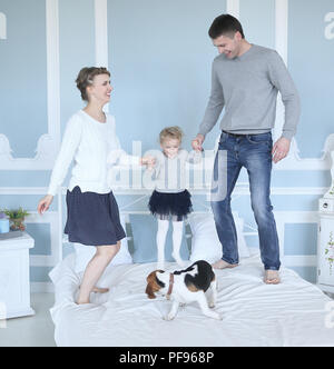 happy family playing in bedroom free day. - Stock Photo