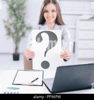 young business woman showing a question mark, - Stock Photo
