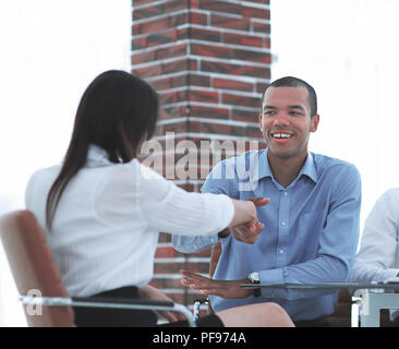 closeup.a handshake of a Manager and employee in the office. - Stock Photo