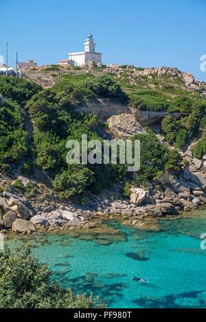 Snorkeler in front of the lighthouse of Capo Testa, Santa Teresa di Gallura, Sardinia, Italy - Stock Photo