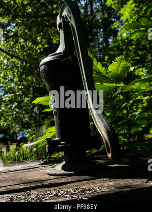 Traditional Cast Iron Manual Water Pump - Stock Photo
