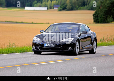 Salo, Finland - August 5, 2018: Black Tesla Model S electric car moves along rural highway on a day of early autumn. - Stock Photo