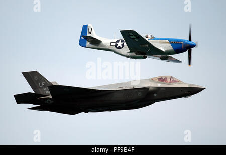 A U.S. Air Force F-35A Lightning II piloted by Captain Andrew 'Dojo' Olson performs a flight with a P-51 Mustang during the 2018 Chicago Air Show - Stock Photo