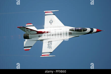 A F-16 Fighting Falcon with the U.S. Air Force Thunderbirds piloted by Major Whit Collins performs a high speed pass during the 2018 Chicago Air Show - Stock Photo