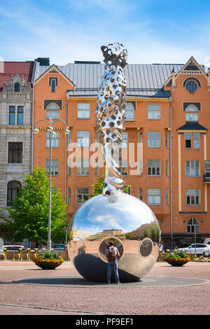 Finland architecture Helsinki, view of Art Nouveau styled buildings and the huge steel Lightbringer monument sited in Kasarmitori square in Helsinki. - Stock Photo