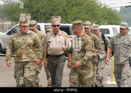 US Army Maj Gen David S Baldwin, left, adjutant general of the California National Guard, arrives with his entourage at the Shasta District Fairgrounds July 30 in Anderson, California, and is escorted by Col Robert Paoletti, commander, 49th Military Police Brigade, July 31, 2018. Image courtesy Staff Sgt. Edward Siguenza/California National Guard. () - Stock Photo