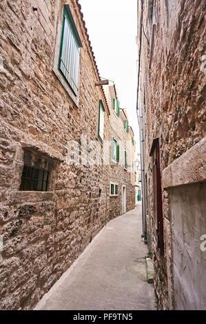 Narrow street in city Vodice in Croatia. - Stock Photo
