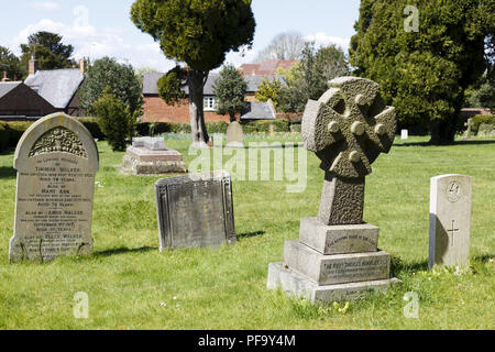 Winslow, UK - April 27, 2015. Old gravestones and headstones in an English graveyard in the historic town of Winslow, Buckinghamshire - Stock Photo