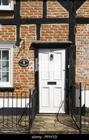 Winslow, UK - April 27, 2015. Traditional Georgian front door on a Tudor cottage in the historic market town of Winslow, Buckinghamshire - Stock Photo
