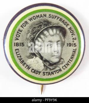 Purple, green and white, suffrage pin with an image of Elizabeth Cady Stanton at the center, ringed by the words 'Votes for Woman Suffrage Nov 2, Elizabeth Cady Stanton Centennial, ' and the dates '1815' and '1915' to commemorate the hundred anniversary of Stanton's birth and the imminent New York Suffrage referendum by the Women's Political Union founded by her daughter Harriot Stanton Branch, issued by the Connecticut Woman Suffrage Association (CWSA) for the American market, 1915. () - Stock Photo