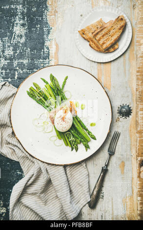 Healthy breakfast with green asparagus, soft-boiled egg , bacon and bread - Stock Photo