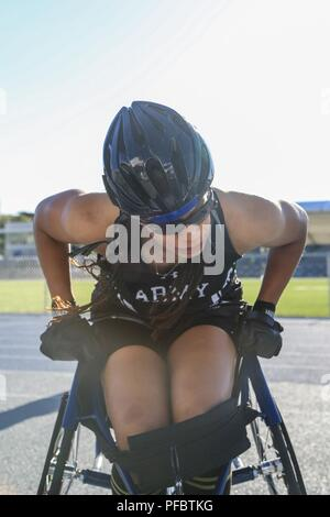U.S. Army Staff Sgt. Altermese Kendrick, Team Army Competitor, gets out of the track wheelchair, Colorado Springs, Colorado June 01, 2018. The DoD Warrior Games is an adaptive sports competition for wounded, ill and injured service members and veterans. Approximately 300 athletes representing teams from the Army, Marine Corps, Navy, Air Force, Special Operations Command, United Kingdom Armed Forces, Canadian Armed Forces, and the Australian Defense Force will compete June 1 – June 9 in archery, cycling, track, field, shooting, sitting volleyball, swimming, wheelchair basketball, and - new this - Stock Photo
