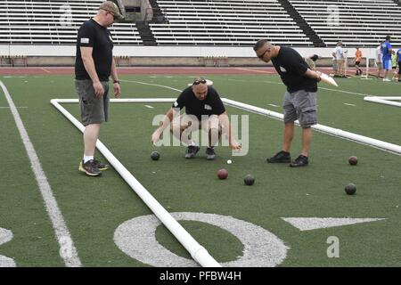 West Virginia Army National Guard Soldiers measure distances during a Special Olympics West Virginia Bocce Ball event held June 2, 2018 at Laidley Field in Charleston. The Special Olympics West Virginia organization is celebrating it's 50th anniversary this year. - Stock Photo