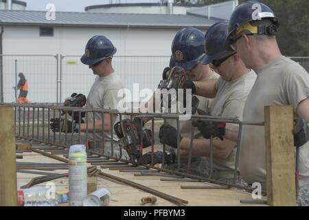 Service members from the 110th Attack Wing Civil Engineer Squadron, Battle Creek Air National Guard Base, Mich., construct rebar cages for foundation and slab reinforcement, Monday, June 4, 2018, at Ādaži Military Base, Latvia, as part of their annual Deployment For Training (DFT). The 110th Civil Engineer Squadron is the fourth Air National Guard rotation supporting the 435th Construction and Training Squadron, Ramstein AB, Germany. The U.S. Air Forces in Europe (USAFE) exercise-related construction projects are intended to provide temporary housing for exercise participants from the United S - Stock Photo