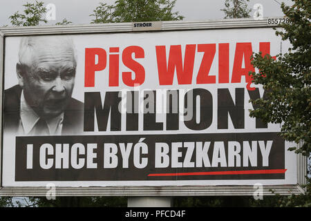 Gdansk, Poland 20th Aug. 2018 Billboard with Jaroslaw Kaczynski face and slogan ' PiS (Law and Justice) took millions, and want to be unpunished ' is seen. Posters financed by the opposition parties displayed across the country refer to giant financial benefits of people connected with the government. Local elections in Poland are scheduled for October 21st. 2018 © Vadim Pacajev / Alamy Live News - Stock Photo