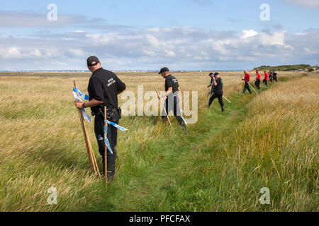 Southport, Merseyside, 21st Aug, 2018. Police search teams, Matrix Police, marine underwater rescue personnel, and the coast guard join forces for a major search of the Marshside Ribble Estuary marshes for missing 20 year old Adam Seaton. Officers are appealing for help to trace missing 20-year-old Adam asking drivers who used a Southport car park to study dashcam footage. Adam Seaton went missing on Thursday 9th August, and his red Ford Fiesta was later found parked near marshland on the seafront promenade. Credit: MediaWorldImages/Alamy Live News - Stock Photo