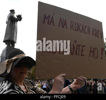 A several people protest after an unveiling of restored memorial to Soviet Marshal Konev with new plaques describing his life and work, in Prague, Czech Republic, on August 21, 2018, day of the 50th anniversary of Warsaw Pact invasion in August 1968 to Czechoslovakia. At the end of World War Two in May 1945, Konev (1897-1973) helped liberate Prague. There have been controversies over the statue due to Konev's participation in the suppression of the Hungarian uprising against the Communist regime in 1956 and the building of the Berlin Wall in 1961. (CTK Photo/Michal Krumphanzl) - Stock Photo