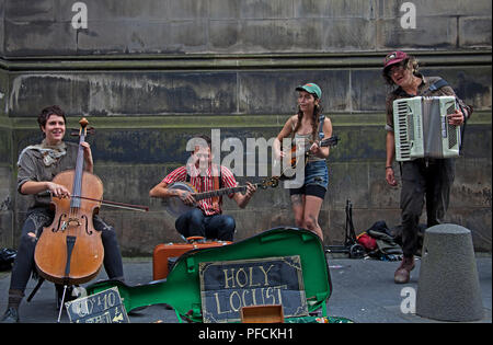 Edinburgh, Scotland, UK, August 2018, Edinburgh Fringe Musicians in the alcoves, Royal Mile. 'Holy Locust' - Stock Photo