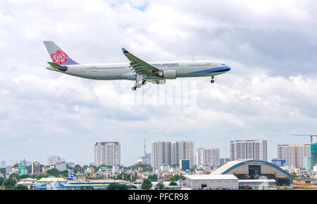 Passenger aircraft Airbus A330 of China Airlines fly over urban areas prepare to landing at Tan Son Nhat International Airport