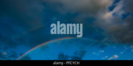 panorama, rainbow in the evening against the background of rain clouds. Web banner. Element of design. - Stock Photo