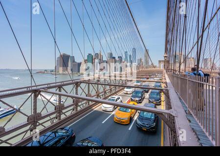 Traffic on the Brooklyn Bridge in New York City - Stock Photo