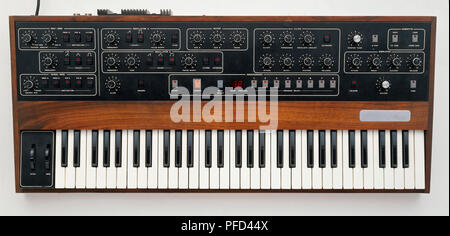 Synthesizer with keyboard and various controls, front view. - Stock Photo