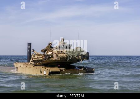 USTKA, Poland (June 7, 2018) A U.S. Marine Corps M1A1 Abrams tank and Marines assigned to Fox Company, Battalion Landing Team, 2nd Battalion, 2nd Marine Regiment, 26th Marine Expeditionary Unit, traverse water to reach land during exercise Baltic Operations (BALTOPS) 2018 at Ustka, Poland, June 7, 2018. BALTOPS is the premier annual maritime-focused exercise in the Baltic region and one of the largest exercises in Northern Europe enhancing flexibility and interoperability among allied and partner nations. - Stock Photo