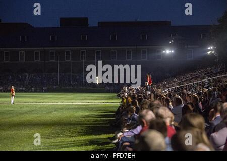 """Gunnery Sgt. Stacie Crowther, assistant drum major, """"The President's Own"""" U.S. Marine Band, salutes the executive officer of Marine Barracks Washington D.C., Lt. Col. Scott Clippinger, during the Friday Evening Parade at the Barracks, June 8, 2018. The hosting official for the parade was U.S. Marine Corps Lt. Gen. Frank McKenzie, director, Joint Staff, and the guests of honor were U.S. Army Lt. Gen. Joseph Anderson, deputy chief of staff for the Army; U.S. Marine Corps Lt. Gen. Brian Beaudreault, deputy commandant, plans, policies and operation; U.S. Navy Vice Adm. Andrew Lewis, deputy chief o - Stock Photo"""