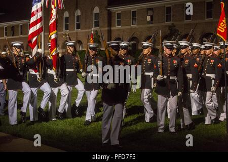Marines with Alpha Company, Marine Barracks Washington D.C., march across the parade deck during the Friday Evening Parade at the Barracks, June 8, 2018. The hosting official for the parade was U.S. Marine Corps Lt. Gen. Frank McKenzie, director, Joint Staff, and the guests of honor were U.S. Army Lt. Gen. Joseph Anderson, deputy chief of staff for the Army; U.S. Marine Corps Lt. Gen. Brian Beaudreault, deputy commandant, plans, policies and operation; U.S. Navy Vice Adm. Andrew Lewis, deputy chief of operations for operations, plans and strategy; and U.S. Air Force Lt. Gen. Mark C. Nowland, d - Stock Photo