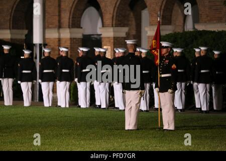 Marines with Bravo Company, Marine Barracks Washington D.C., perform during the Friday Evening Parade at the Barracks, June 8, 2018. The hosting official for the parade was U.S. Marine Corps Lt. Gen. Frank McKenzie, director, Joint Staff, and the guests of honor were U.S. Army Lt. Gen. Joseph Anderson, deputy chief of staff for the Army; U.S. Marine Corps Lt. Gen. Brian Beaudreault, deputy commandant, plans, policies and operation; U.S. Navy Vice Adm. Andrew Lewis, deputy chief of operations for operations, plans and strategy; and U.S. Air Force Lt. Gen. Mark C. Nowland, deputy chief of staff  - Stock Photo