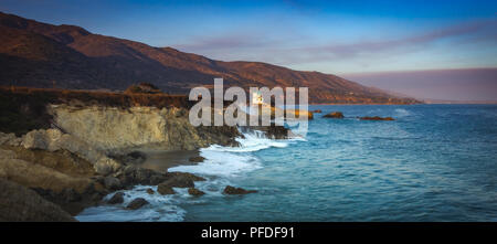Colorful coastal view of Leo Carrillo State Beach at sunset from Sequit Point, Malibu, California - Stock Photo