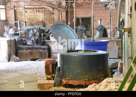 Machinery for processing wool for use in the making of traditional hats at the Sombreros Sucre factory in Sucre, Bolivia - Stock Photo