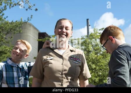 BANGOR, Wash. (June 11, 2018) Senior Chief Hospital Corpsman Christine Moore, assigned to the Gold crew of the Ohio-class guided missile submarine USS Ohio (SSGN 726), is promoted to the rank of senior chief petty officer by her family members during a ceremony at Naval Base Kitsap-Bangor. Ohio is currently moored at Puget Sound Naval Shipyard and Intermediate Maintenance Facility undergoing a major maintenance period. - Stock Photo