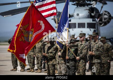 A multinational color guard comprised of Marines with Special Purpose Marine Air-Ground Task Force - Southern Command and a Honduran Army soldier present colors during an opening ceremony on Soto Cano Air Base, Honduras, to mark the beginning of SPMAGTF-SC deployment to Latin America and the Caribbean, June 11, 2018. The Marines and sailors of SPMAGTF-SC will conduct security cooperation training and engineering projects alongside partner nation military forces in Central and South America during their deployment. The unit is also on standby to provide humanitarian assistance and disaster reli - Stock Photo
