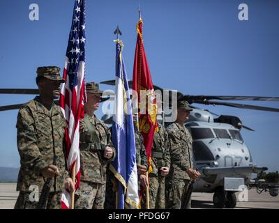 A multinational color guard comprised of Marines with Special Purpose Marine Air-Ground Task Force - Southern Command and a Honduran Army soldier stand at ease during an opening ceremony on Soto Cano Air Base, Honduras, to mark the beginning of SPMAGTF-SC deployment to Latin America and the Caribbean, June 11, 2018. The Marines and sailors of SPMAGTF-SC will conduct security cooperation training and engineering projects alongside partner nation military forces in Central and South America during their deployment. The unit is also on standby to provide humanitarian assistance and disaster relie - Stock Photo