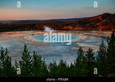 Sunset landscape view of the Grand Prismatic Spring in Yellowstone National Park, USA - Stock Photo