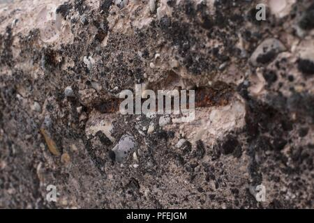 A Structural damage rusted concrete reinforcement - Stock Photo