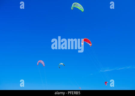 Kites flying high in the sky, Tarifa, Costa de la Luz, Cadiz Province, Andalusia, Spain. Europe - Stock Photo