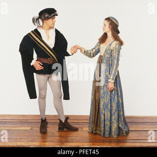 Man and woman dressed in 16th century clothing - Stock Photo