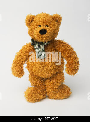 529bbf5a6d8 ... Teddy bear with black and white check ribbon tied around its neck -  Stock Photo