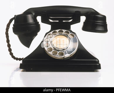 Black telephone with rotary dial, close up. - Stock Photo