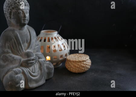 buddah witn candle spa concept - Stock Photo