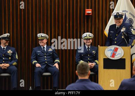 Command Master Chief Petty Officer James Bach gives his speech during the Coast Guard's Ninth District change-of-watch ceremony in Cleveland, Ohio, June 6, 2018. Master Chief Petty Officer Jahmal Pereira (left) assumed the watch from Bach. - Stock Photo