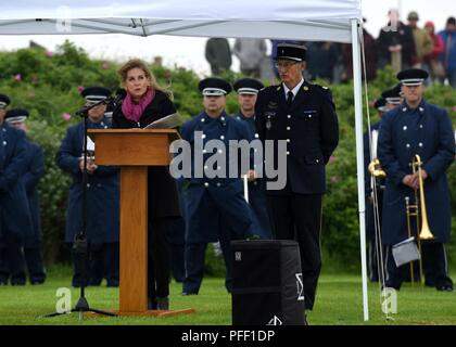 SAINTE-MARIE-DU-MONT, France (June 6, 2018) U.S. Ambassador to France Jamie McCourt speaks during the Utah Beach Federal Monument Ceremony. This year marks the 74th anniversary of Operation Overlord, the Allied invasion of Normandy on June 6, 1944 -- most commonly known as D-Day. An epic multinational amphibious and airborne operation, D-Day forged partnerships and reinforced transatlantic bonds that remain strong today. Overall, U.S. service members from 20 units in Europe and the U.S. participated in events and ceremonies May 30-June 7, 2018, in almost 40 locations throughout the Normandy re - Stock Photo